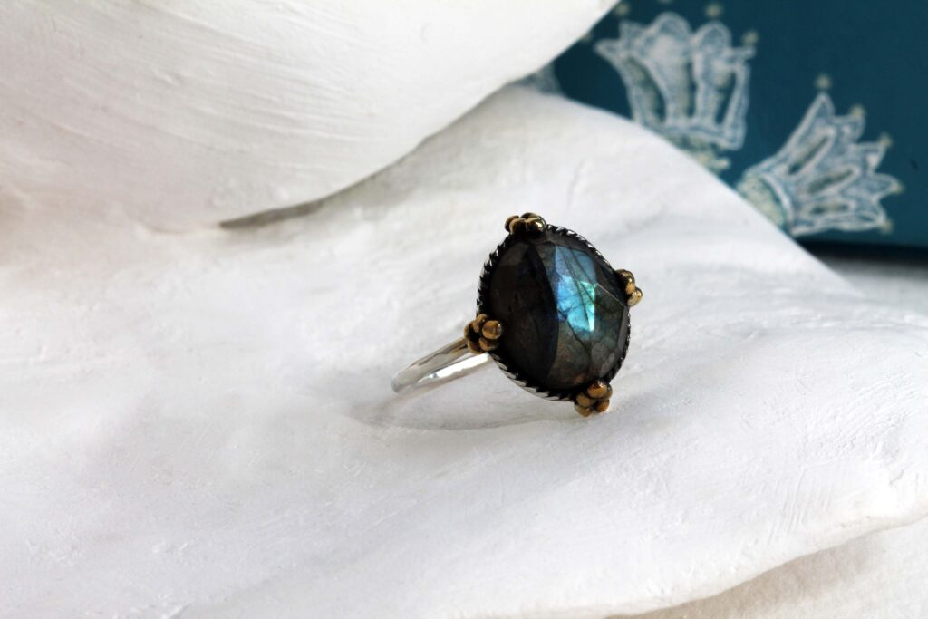 A Banyan Jewellery statement ring with faceted green/blue labradorite