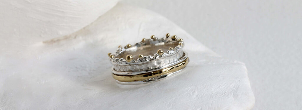 A Banyan Jewellery crown shaped ring decorated with hammered revolving rings