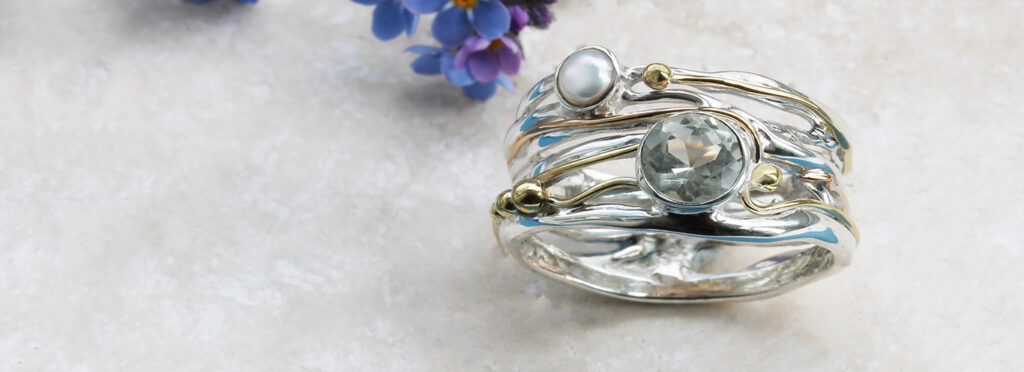 A Banyan Jewellery silver ring decorated with green amethyst and white freshwater pearl